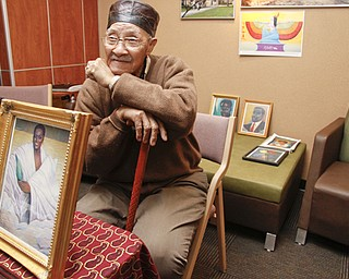 Youngstown artist Joseph Thomas with his artwork at YSU's African Marketplace for Black History Month in the Chestnut room at Kilcawley Center, Saturday February 7, 2009