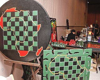 "Professor Peacock (49) of Columbus stated that in chess ""white moves first -so its subliminally racist."" Playing chess has been proven to improve test scores, so he crafts chess board tables and pieces to encourage youth to learn strategies instead of participating in gangs. YSU's African Marketplace for Black History Month in the Chestnut room at Kilcawley Center, Saturday February 7, 2009  ** If you also want to diminish youth violence, You may contact him at testscorerise@yahoo.com"