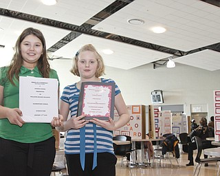 McGuffey 5th Graders Tabatha West (11) and Kaitlyn Geisel (11) displayed her project at the Youngstown City Schools All-City Science Fair at East High School, Saturday February 7, 2009