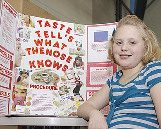 McGuffey 5th Grader Kaitlyn Geisel (11) displayed her project at the Youngstown City Schools All-City Science Fair at East High School, Saturday February 7, 2009