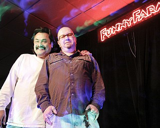 Funny Farm Comedy Club Entertainment Director Eric Stevens and Proprietor Chris Jackson on stage