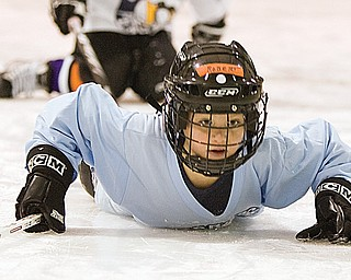 Robert Lachman, age 7 of Lake Milton, falls to the ice during a drill of red light green light at the Ice Zone in Boardman Monday afternoon. Approximately, 50 area youth attended a Learn to Skate Program hosted by the Mahoning Valley Phantoms where the first 30 participants received free jerseys and equipment donated by Pittsburgh Penguin Sidney Crosby.