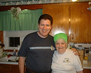 HAIR TODAY: Florence Dailey of Youngstown is pictured with her son, Michael Dailey, on St. Patrick's Day in 2008. Florence always celebrates the holiday in style by coloring her hair green.