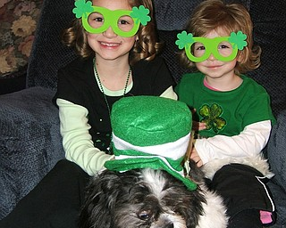 PUPPY LOVE: Madison and Alivia Horvath are shown with their cousin's puppy, Max. The girls are the daughters of Rick and Kelley Horvath of New Middletown.