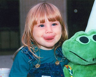 KERMIT AND FRIEND? Leanna Hartsough of Canfield was showing Grandma Lana VanAuker of Canfield her best frog face.