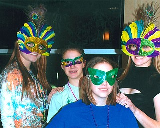 PARTY GIRLS: A group of Canfield High School students are in their best disguise for the Mardi Gras party at Salem Community Center.