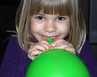 BURSTING WITH PRIDE: Samantha Jones, 4 1/2, of Canfield has success in blowing up her green balloon! Photo was taken by her mom, Sally Jones.