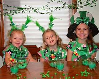 THE GREEN GIRLS: The DiFabio sisters, Julianna, 16 months, Arianna, 3, and Brianna, 5, of Poland are enjoying their St. Patrick's Day cottage cheese and green milk.