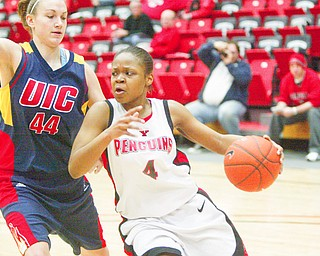 Jaquetta WEstley of YSU drives around Kristen Petrinec of UIC .