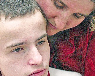 Debbie Maust of Canfield shares a moment with her son Collin, 14, who is a student at The Rich Center for Autism in Youngstown.