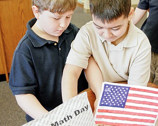 Lowellville 3rd graders Kyle Baird, left, and Nick Kacir prepare for World Math Day event at their school Wednesday.