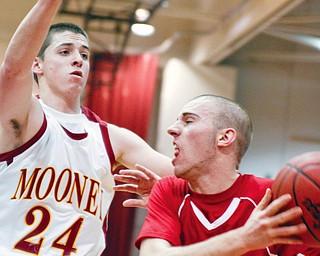 Mooney Eddie Reese (24) blocks Salem Jordon Strabala (11) at Boardman High School, Wednesday March 4, 2009