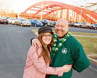 Stef Grimaldi, of Boardman, and Joe Halas, of Austintown, stop for a photograph in front of the Firefighters bridge on their way to the B&O during the dash Friday evening.