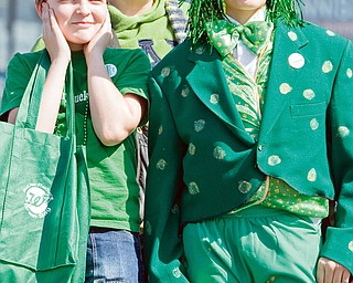 "Jeremy Brown, 12, mother Maryann Brown, both of Homeworth, and friend, Parker Zamarelli, of Salem stand along Market Street during the 31st annual Mahoning Valley St. Patrick's Day Parade. ""Its really cool,"" said Zamarelli who  said he hadn't been the the parade since he was much younger as he dawned an frog costume recently worn in a school production."