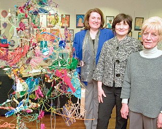 Art Instructor, Mary Beth Wensel, Supervisor, Michele Krisher, and Art Instructor, Kathy Young, stand along a sculpture made by students from Trumbull Co. Educational Service Center Arts Excel in the Arts Outreach Center at Eastwood on Sunday afternoon.