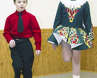 Walter Sweeney, 7, of Canfield and Mary Kate Kelty , 7, of Poland are among the younger dancers in the Burke school of Irish Step dancing.