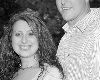 Kathleen E. Raymond and William J. Mertel