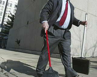 Scott Burin, owner of the International Towers building in downtown Youngstown, Oh. goes through his daily ritual of picking up litter from his property.