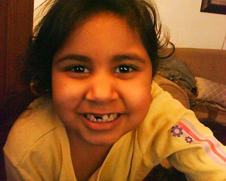 ALICIA CORTEZ of Youngstown, who is in kindergarden at Byzantine Catholic Central School, smiles after losing another tooth.