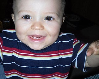 JAMES ARTHUR WHITE IV, 10 months old, of Fort Hood, Texas, shows his grandma, Rosemarie White of New Bedford, Pa., his toothless grin during a recent visit.