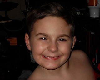 JOEY NAPLES, 7, of Youngstown shares his toothless grin.