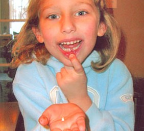 Jen Kadilak sent this picture of her daughter, KATE, age 6, showing off her first missing tooth. The family lives in Canfield.