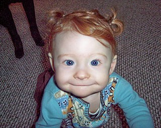 This is KIRA MCAFOOSE, who will be 1 on Tuesday. She is still awaiting her first tooth! She is the daughter of Kimberly and Gary McAfoose of McDonald.