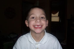Six-year-old NATHAN LESKOVAC, son of Tom and Amy Leskovac, Austintown, shows off his toothless smile.