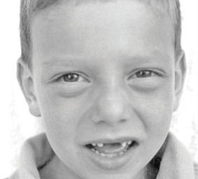 "LOGAN CLARK, son of Kevin and Kimberly Clark of Columbiana, could be saying ""Hey, what happened to my teeth?"""
