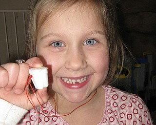 "MADDIE WILLS, 6, lost her first tooth and shows off her ""tooth box."" She is the daughter of Chris and Staci Wills of Canfield."