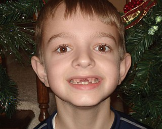 "TREVOR OF BOARDMAN lost his two front teeth in time to sing ""All I Want For Christmas Are My Two Front Teeth"" in December 2007, when he was 9 years old."