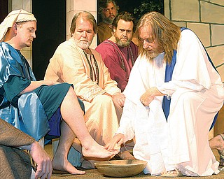 Jesus played by Dennis Carpenter washes the feet of his apostles Saturday afternoon in Niles.
