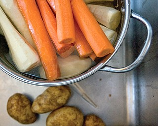 Potatoes, carrots, and parsnips for a use in a Passover meal at Ohev Tzekek Synagogue in Youngstown on Wednesday.