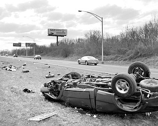 A red ford pick up truck lays overturned in the median of 680 after leaving the roadway of 680 south. Youngstown  Police responded to the accident where the vehicles only occupant was a male who was ejected from the vehicle and taken away from the scene by an ambulance most likely headed to St. Elizabeth's.