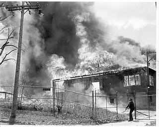 Apr. 26, 1984 Fireman drags hose towards the blaze.