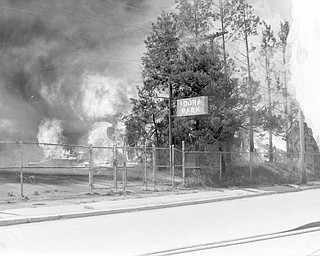 Idora park sign with fire all around. Apr. 26, 1984