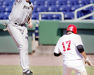 YSU's Jeremy Banks heads to first as Milwaukee 1 rst baseman Dan Buchloz tries to make the catch during 4 th inning at Eastwood Field. Banks was called safe.