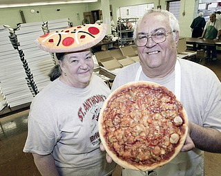Steve and Marian DeGenaro in the kitchen at St Anthony Church in Youngstown Friday 4-24-09. They and about 25 volunteers make and sell several hundred pizza's/week as a church fundraiser.