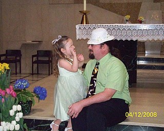 EMMA GARON, 3, of Hubbard thought her Easter bonnet looked better on her daddy, Adam.