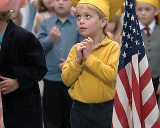 NICHOLAS LAPLANTE wears his favorite cap, graduating from preschool at