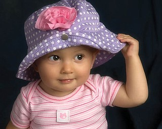 1-year-old HANNAH LAPLANTE shows off her favorite spring hat.