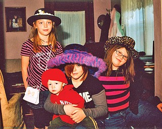 CHEROKEE and WYATT INGRAM (8 and 16 months old), KYRSTIN BRADFORD, 16, and HOPE INGRAM, 9, all of Struthers, are the grandchildren of Ray and Sue Bradford, also of Struthers.