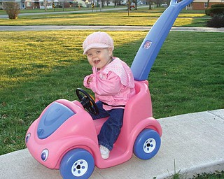 One-year-old MARY GIOVANNA of Boardman loves putting on her pink hat and going for a ride in her pink car.