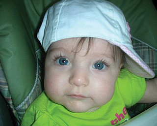 AVA VALENTINA ACEVEDO, 5 months, daughter of Toni and Rob Acevedo and granddaughter of Paula Shields, is a serious hat lover.