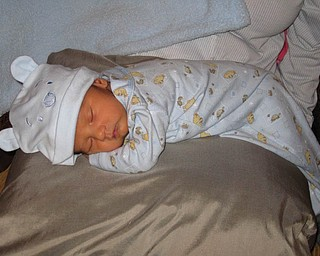 MATTEO JALEN SKURICH is only eight days old here. He is sporting his favorite hat — a Winnie the Pooh blue cap. He is the son of Ruth and Matthew Skurich.