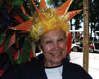 ROSEMARIE ECKENRODE of Boardman could't resist trying on some of the crazy hats in the shops at Put in Bay.