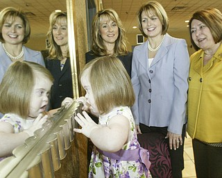 <p>REFLECTING: As they prepare for the Angels of Easter Seals fashion show and luncheon on May 14 at Mr. Anthony's in Boardman, from left, Deborah Liptak, Angels president; and Jill Chesney and Mary Celeste Van Sickle, chairs of the event, share a moment with Marina Donadio, 3, who is intrigued by her mirrored reflection.</p>