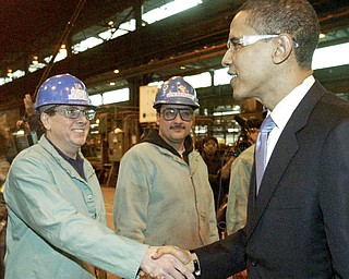 Barack Obama shakes hands with RTI employee Bernie Desmond of Girard during a visit 02/12/08 to the Niles plant. In background is Len Bergana. William D. Lewis/ The Vindicator