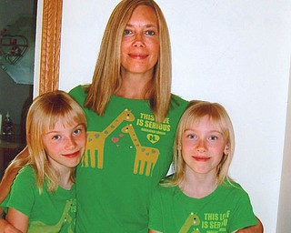 Kim Patton, 44, with twin 10-year-old daughters, Emily Hawkins, left, and Lily Hawkins, all of Columbiana.