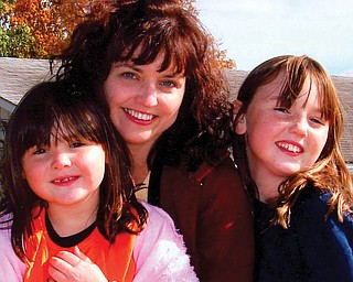 Katrina Wolfe with daughters, KayLee and Kacey, of Columbiana.